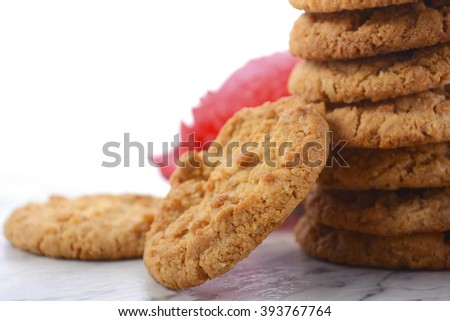 ANZAC Day, April 25, traditional Anzac biscuits on white marble table with red poppies, closeup.  - stock photo