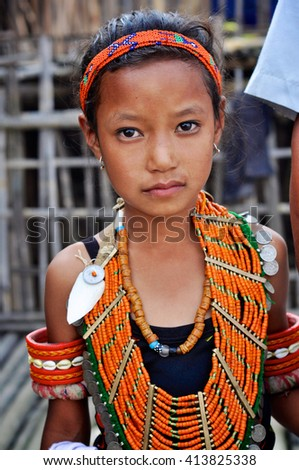 Aoleang, Nagaland, India - April 2012:  Small girl in traditional costume during Aoleang festival in Aoleang, Nagaland, India. Documentary editorial.