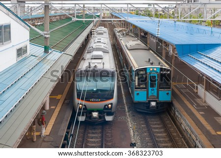 AOMORI , JAPAN - AUGUST 2: Resort Shirakami tourist train (left) and local train (Right) at Aomori station on August 2 , 2012 in Aomori city, Japan.