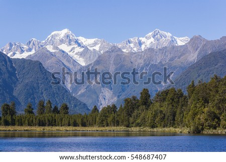 Aoraki/Mount Cook (3754m) is the highest mountain in New Zealand and is seen here from Lake Matheson with Mount Tasman (3497m) on the left.