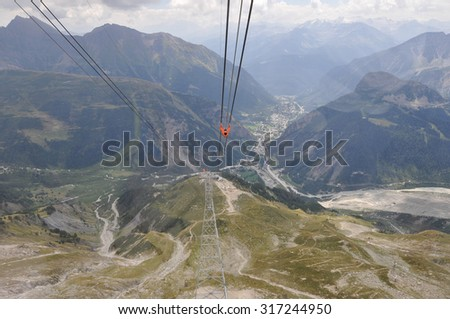 AOSTA VALLEY, ITALY - AUGUST 06, 2015: The new SkyWay aerial tramway links the city of Courmayeur with Pointe Helbronner on the top of Mont Blanc massif
