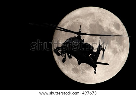 Apache helicopter silhouetted by a full moon - stock photo