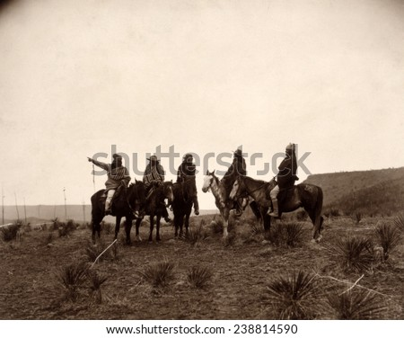 Apaches. The lost trail- Five Apache on horseback in the desert. photo by Edward S. Curtis, 1903 - stock photo
