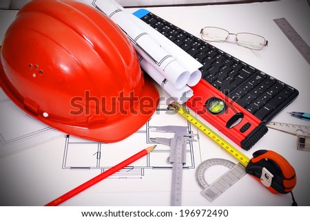 apartment  blueprint and tools on desktop, workspace engineer - stock photo