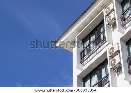Apartment Building and blue sky - stock photo