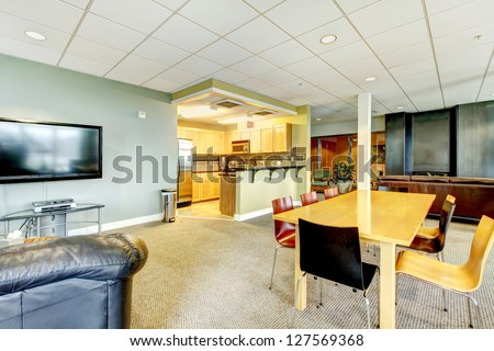 Apartment building modern living room with kitchen general area with TV. - stock photo