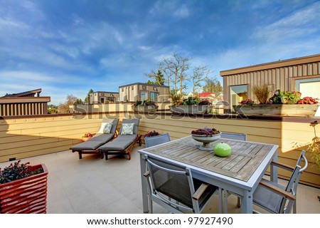 Apartment building roof top terrace exterior with modern living area. - stock photo