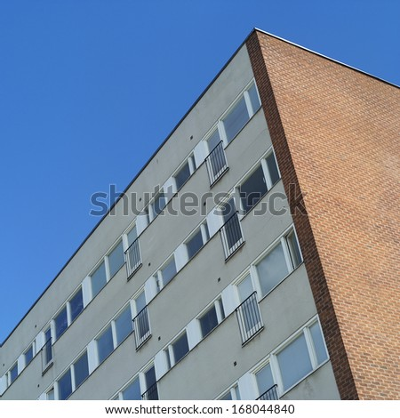 Apartment Building towards blue sky
