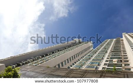 apartment building under blue sky - stock photo