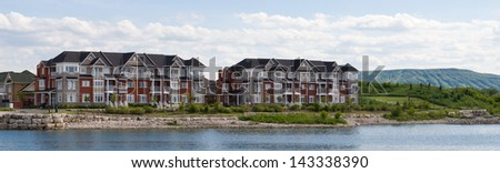 Apartment buildings and a mountain with ski slopes