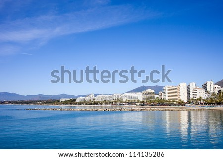 Apartment buildings by tranquil Mediterranean Sea in resort town of Marbella on Costa del Sol in Spain, Andalusia region, Malaga province.