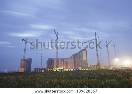 Apartment buildings under construction in suburban area