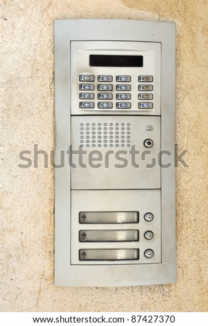 Apartment buzzers with push buttons and intercom - stock photo