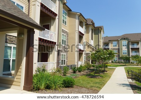 Apartment complex stock images royalty free images for Find a builder in your area