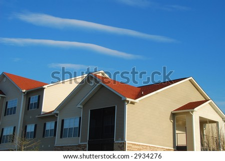 Apartment Complex Under Blue Sky - stock photo