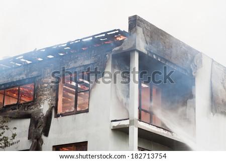 Apartment house burns - stock photo