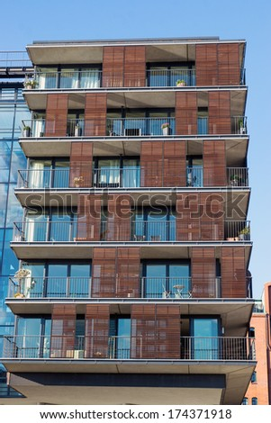Apartment house with a lot of glass - stock photo