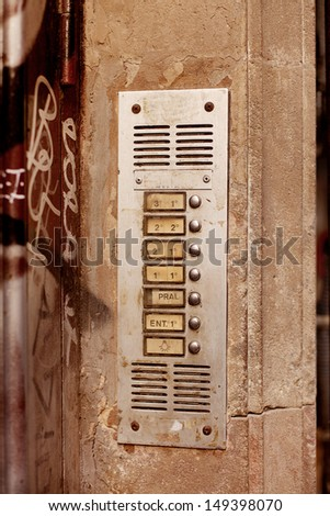 Apartment Intercom mounted on wall at front door of city apartments, Barcelona - stock photo