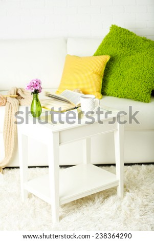 Apartment interior in white color with bright decorative elements