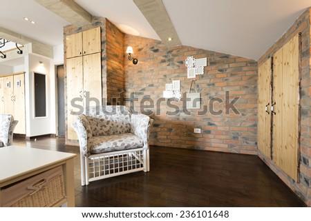 Apartment interior  - wardrobe area made of bricks - stock photo