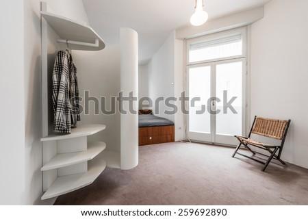 Apartment interior with modern white closet  - stock photo