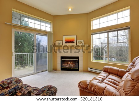 Apartment living room interior with yellow walls, high ceiling and large windows. Northwest, USA