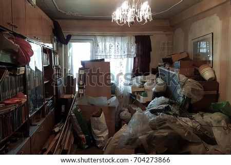 Apartment of a pensioner who suffers from compulsive hoarding, littered with trash and books