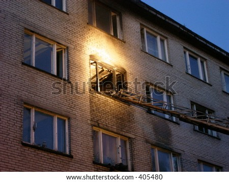 Apartment on fire - stock photo