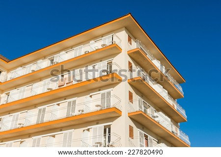 Apartments building with balconies. - stock photo
