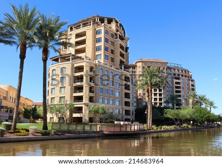 Apartments on river walk with palm trees in an upscale neighborhood - stock photo