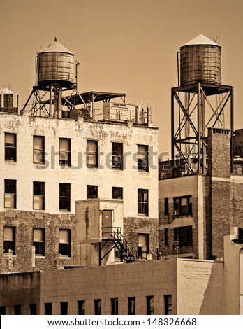 Apartments with water towers in New York City - stock photo