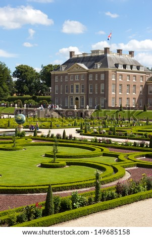 APELDOORN, NETHERLANDS - JUL 22: Palace Het Loo and it's gardens.  on July 22, 2012 in Apeldoorn, The Netherlands. Build in 1686 and residence of the Royal Dutch family till 1962. - stock photo