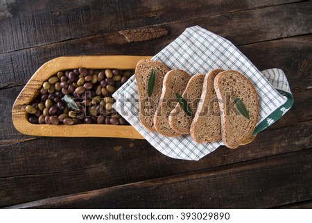 Aperitif made of bread with mixed olives in brine of Tuscany Italy - stock photo