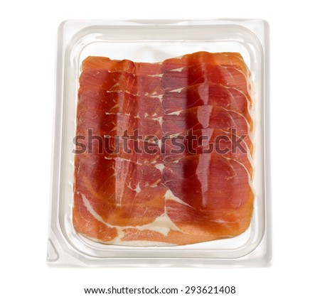 Apetitnye slices of ham in a plastic transparent blister. Isolate on white. - stock photo