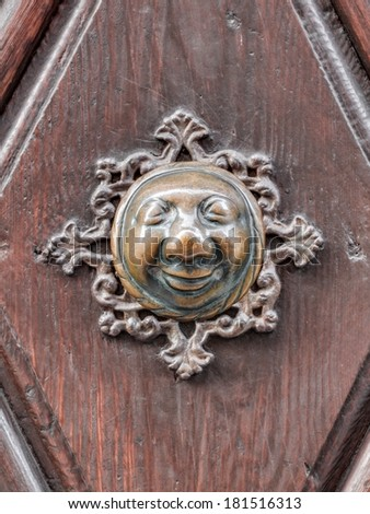 Apfelweibla, Vintage doorknob on antique door, background. Famous knob with an old woman face from the tale of ETA Hoffmann in the city of Bamberg in Bavaria, Germany , Unesco world culture heritage