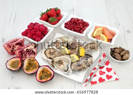 Aphrodisiac love food selection for good sexual health over distressed white wood background.