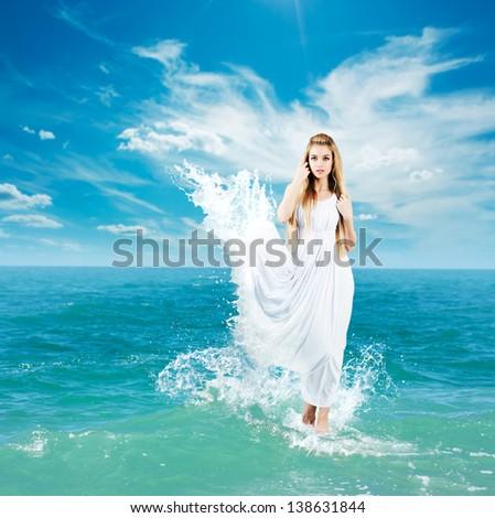 Aphrodite Styled Woman in Splashing Dress Walking on Water. Ancient Greek Goddess Collage. - stock photo