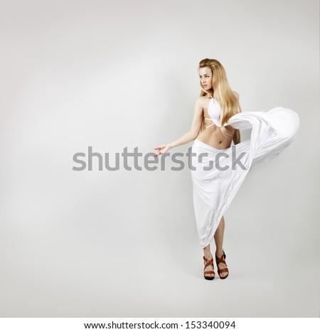 Aphrodite Styled Woman in Waving White Dress. Ancient Greek Goddess. - stock photo