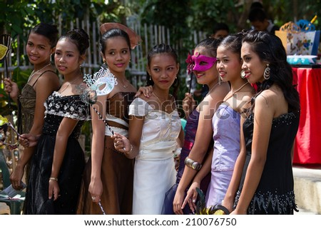 APO, PHILIPPINES - FEBRUARY 12, 2014 : Unidentified filipino students in the school yard have a masquerade ball - stock photo
