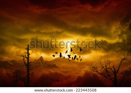 Apocalyptic dramatic background - lightnings in dark red sky, flock of flying ravens, crows in dark red moody sky - stock photo