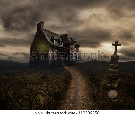 Apocalyptic Halloween scenery with old house, skull and grave - stock photo