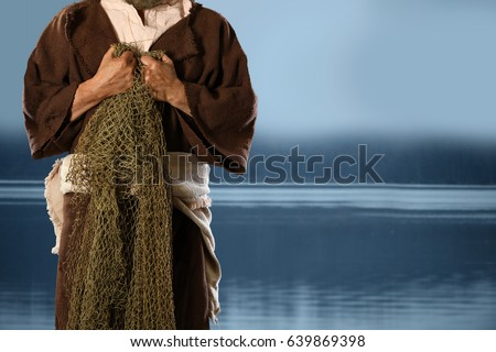 Apostle and fisherman holding nets with lake in background