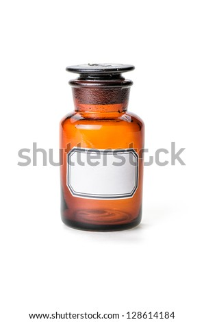 Apothecary bottle made of brown glass with empty label - stock photo