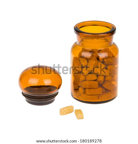 Apothecary bottle with pills isolated on white - stock photo