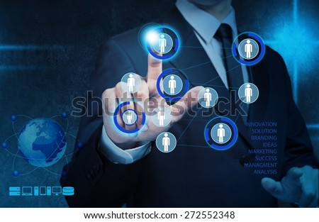 App. Businessman pressing modern social buttons on a virtual computer - stock photo