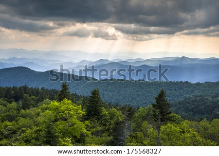 Appalachian Mountains Blue Ridge Parkway Western North Carolina featuring crepuscular rays of light over endless mountain ridges in summer