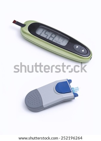 Apparatus for measuring blood glucose on white background - stock photo