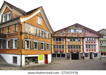 APPENZELL, SWITZERLAND- JUNE 29, 2015: Ancient unique colourful house in historic medieval old town. Appenzell is well-known for its colourful houses with painted facades. - stock photo