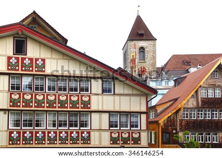 APPENZELL, SWITZERLAND- JUNE 29, 2015: Ancient unique painted windows in historic medieval old town. Appenzell is well-known for its colourful houses with painted facades.  - stock photo