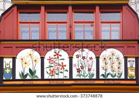 APPENZELL, SWITZERLAND- JUNE 29, 2015: Ancient unique window in historic medieval old town. Appenzell is well-known for its colourful houses with painted facades. - stock photo
